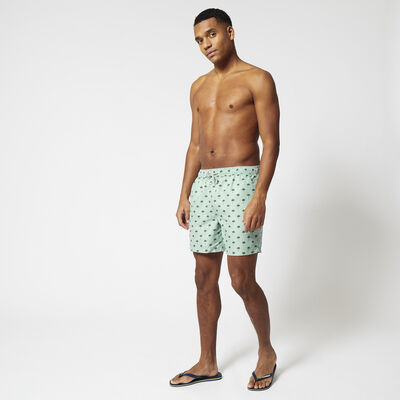 Swimming trunks with all over print